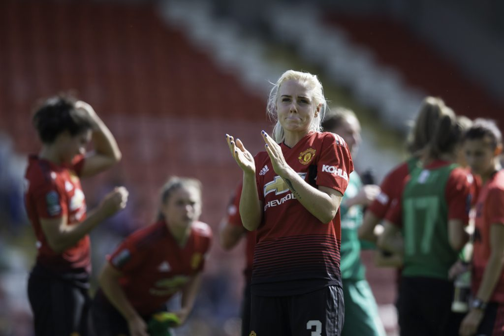 Alex Greenwood applauding the fans