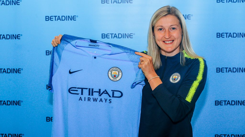 Ellen White holding Man City shirt