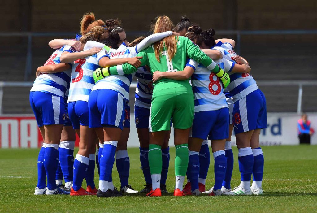 Reading FC Women in huddle on pitch