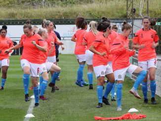 Blackburn Rovers Ladies warm up.