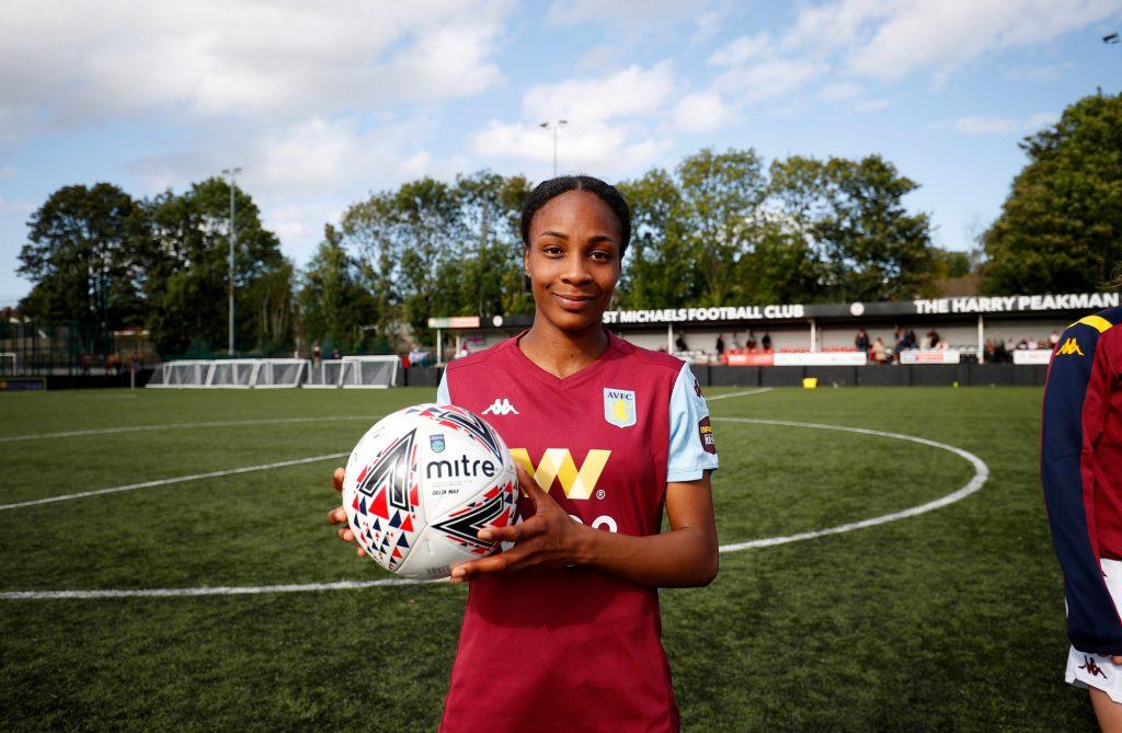 Melissa Johnson of Aston Villa Women celebrates the match ball.