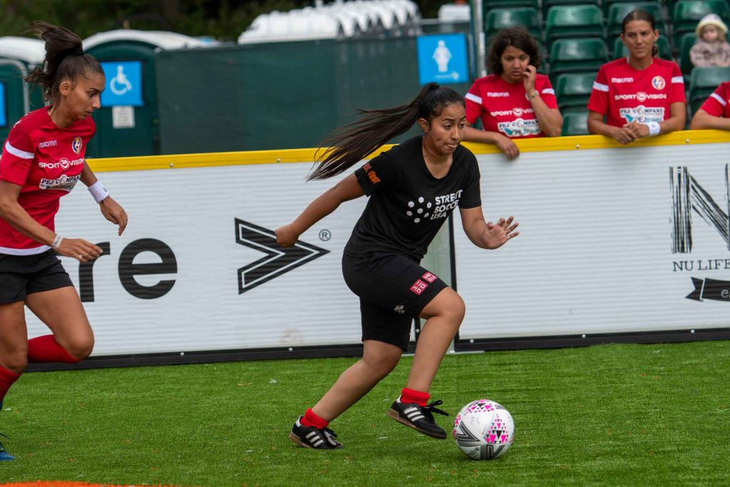 Street Soccer USA player dribbling the ball at Homeless World Cup