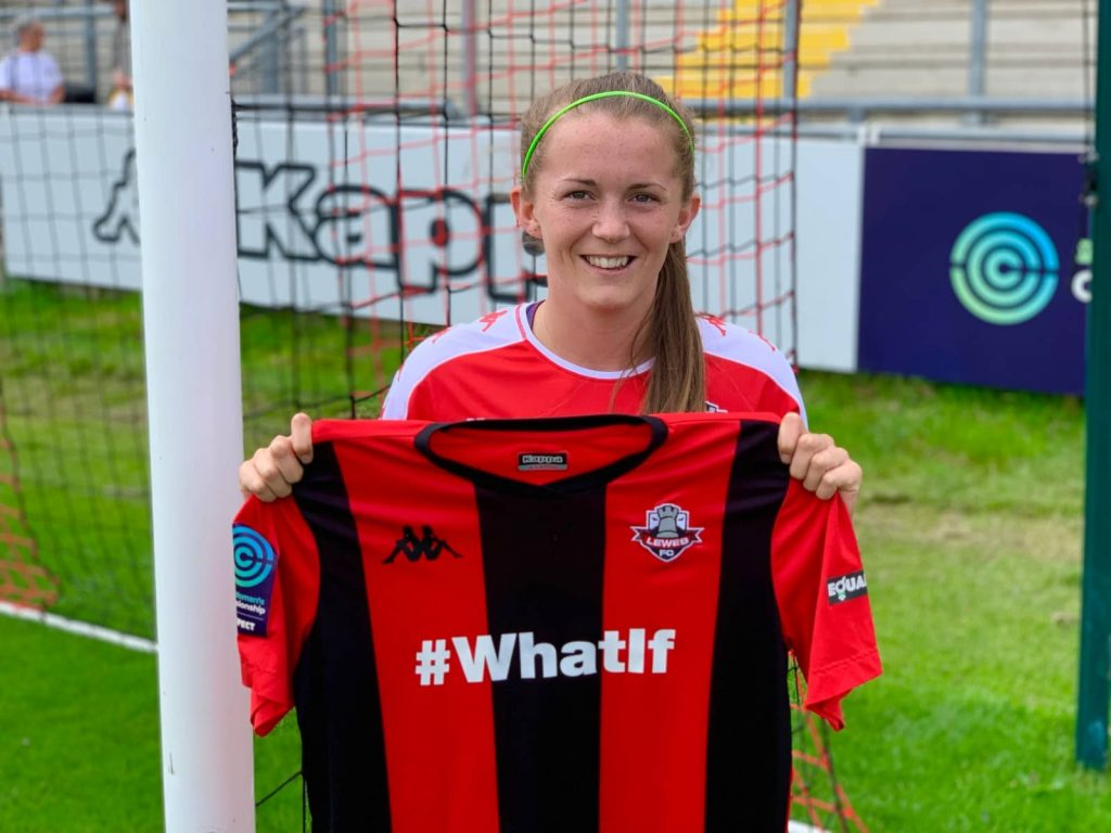 Molly Peters holding up Lewes FC shirt