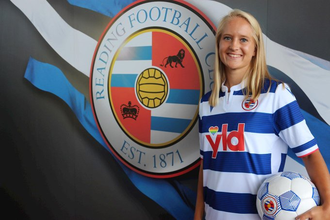 Amalie Eikelad in front of Reading FC Crest