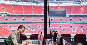UCFB student studying inside Wembley Stadium