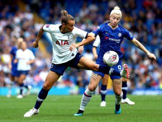 Ria Percival of Spurs challenges Chelsea's Bet England