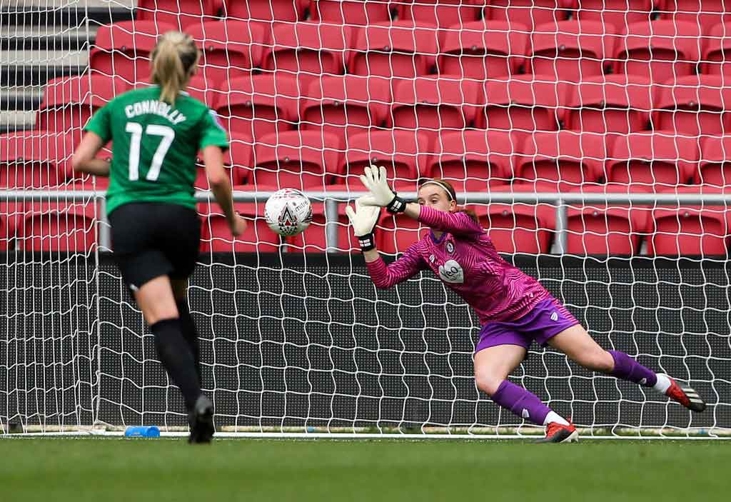 Sophie Baggaley saves a penalty