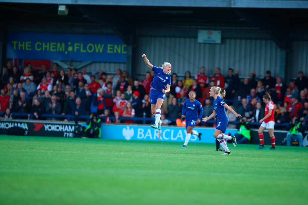 Chelsea celebrate a goal in the defeat of Arsena