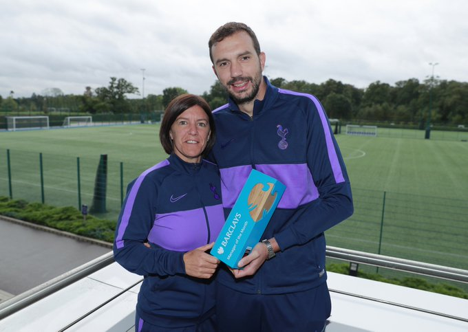 Karen Hills and Juan Amoros receiving the Barclays Manager of the Month Award
