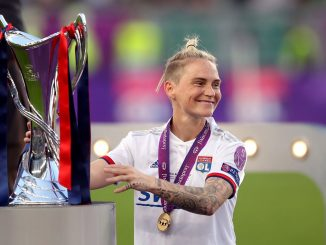 Lyon's Jess Fishlock with UWCL trophy in 2019