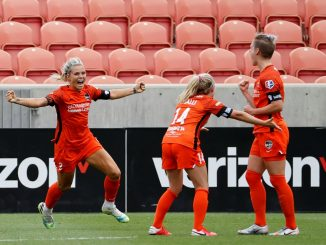 Rachel Dlay celebrates with Houston Dash teammates