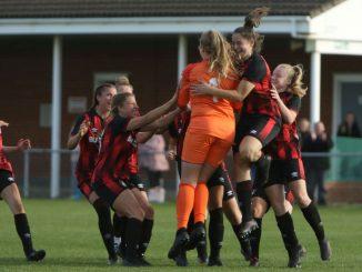 AFC Bournemouth celebrate winning on penalties