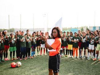 Lola Ogunbote leading a session at Goals for Girls
