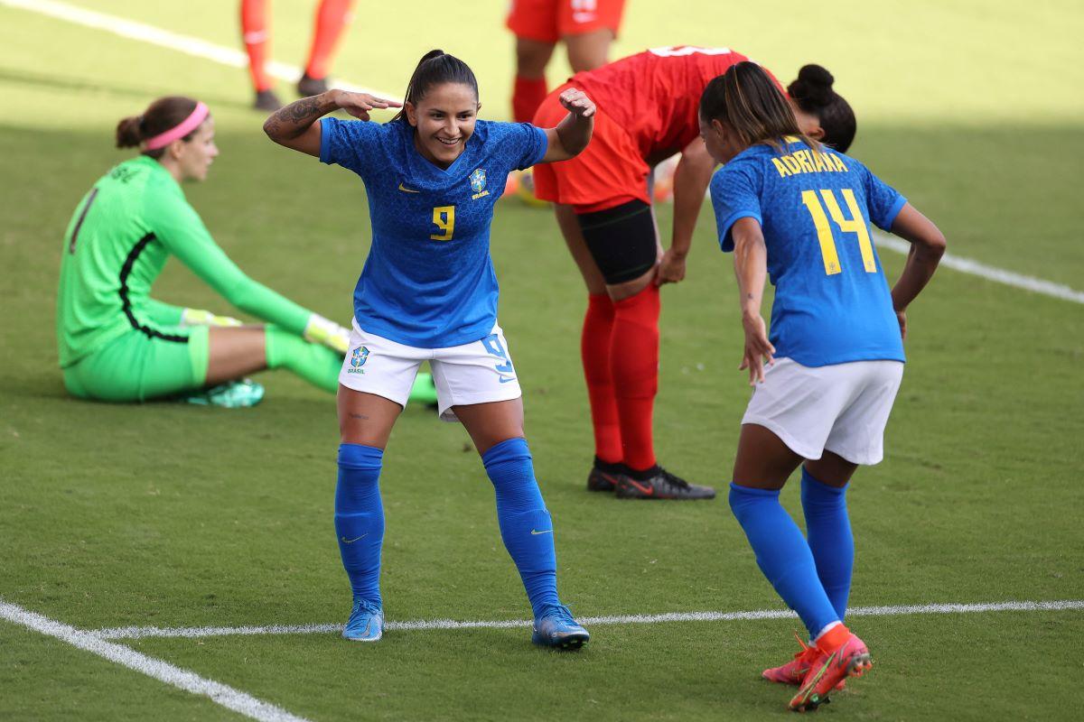 Brazil forward Debinha celebrates